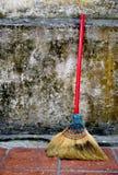 Broom towards wall stock photo