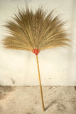 Broom. The traditional asain broom rest against the wall royalty free stock image