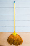 Broom. Vertical photo of a simple household corn broom royalty free stock photography
