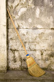 Broom in a wall Stock Photos