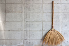 Broom on the wall Royalty Free Stock Photography