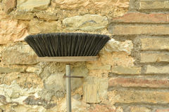 Broom on the wall Royalty Free Stock Image
