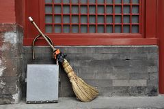 Broom and waste basket Royalty Free Stock Image