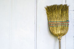 Broom on a white wall Royalty Free Stock Photography