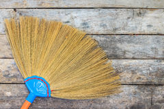 Broom on a wooden floor Stock Photography