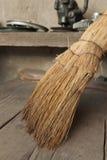 Broom on the wooden floor Stock Photo