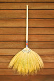 Broom on wooden wall. Broom hanging on the wooden wall ready for cleaning work Royalty Free Stock Photos