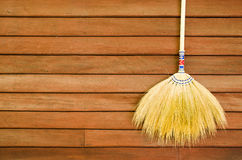 Broom on wooden wall Stock Image
