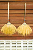 Broom on wooden wall Royalty Free Stock Photo