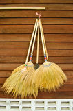 Broom on wooden wall Stock Images