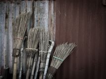 Broom with the zinc wall Stock Photography
