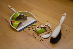 Brooming broken flower pot. With small brush stock image