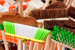 Brooms. Colorful brooms in a market stall Royalty Free Stock Photography