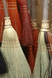 Brooms. Hanging on a wall stock image