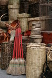 Brooms and baskets. Brooms and wicker baskets for sale at market Royalty Free Stock Image