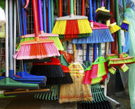 Brooms and brushes. Variety of colorful brooms and brushes Royalty Free Stock Image