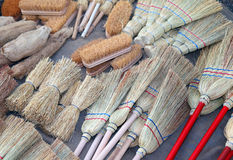 Brooms and brushes of sorghum in retail market. Brooms and brushes of sorghum in local market Royalty Free Stock Photos