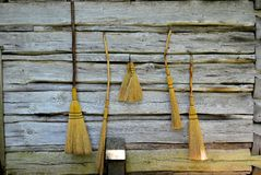 Brooms on the Cabin Wall Stock Photos
