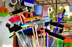Brooms and Cleaning Supplies. Colorful brooms and cleaning supplies Royalty Free Stock Photos
