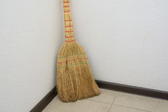 Brooms on the floor Stock Photography