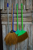 Brooms. Hanging on the wall Stock Photo