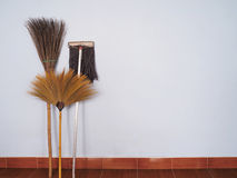 Brooms and mop for cleaning Stock Photos