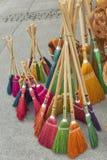 Brooms sells at street market stock photos
