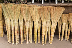 Brooms sold on the market Royalty Free Stock Images