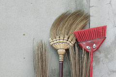 Brooms stick on brick wall Royalty Free Stock Photo