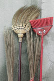 Brooms stick on brick wall Royalty Free Stock Photos