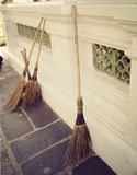 Brooms on the Stone Sidewalk Stock Images
