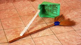 Brooms and trash cans that are old and unattractive royalty free stock photos