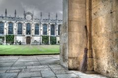 The Broomstick at All Souls College, Oxford. A broomstick has been casually left, propped against the stone wall at one of the Oxford University Colleges. The Stock Photography
