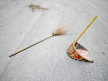 Broomstick and dustpan on the street Royalty Free Stock Photos