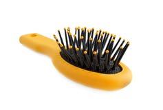 Brosse à cheveux pour des cheveux sur un fond blanc photos stock
