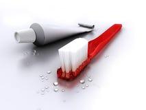 Brosse à dents avec le tube de pâte dentifrice Photographie stock libre de droits