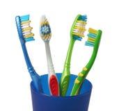 Brosse à dents de brosse à dents en verre sur le blanc Photographie stock