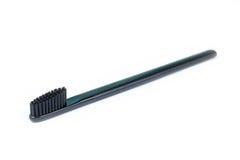 Brosse à dents de plan rapproché Pour les hommes Pleine brosse noire D'isolement sur un whi Photographie stock