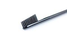 Brosse à dents de plan rapproché Pour les hommes Pleine brosse noire D'isolement sur un whi Image stock