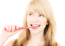 brosse à dents heureuse de fille Photo stock