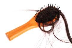 Brosse de cheveux avec les cheveux perdus là-dessus Images stock