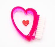 Brosse de nettoyage de poignée de forme de coeur de couleur rouge Image libre de droits