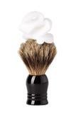 Brosse de rasage avec la mousse d'isolement sur le blanc Image stock