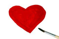 Brosse dessinée par forme de coeur avec la peinture rouge Photo stock