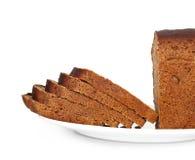 Brot auf der Platte getrennt Stockbild