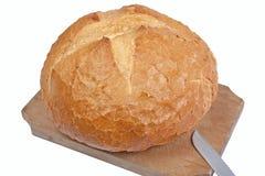 Brot auf hölzernem Ausschnittvorstand Stockfotos