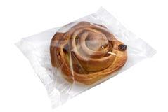 Brot im transparenten Plastikfolie Stockfotos