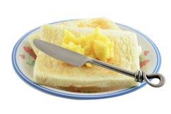 Brot mit Butter und Messer Lizenzfreie Stockfotos