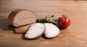 Brot mit Butter und Tomate Stockbild