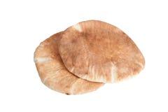Brot mit zwei Pittabroten lokalisiert auf weißem Hintergrund Lizenzfreie Stockfotografie